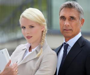bigstock-Business-couple-standing-outsi-22060589